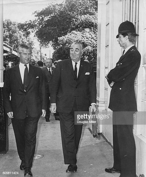 Air Vice Marshal Christopher FoxleyNorris a Admiral Pierre Poncet arriving for AngloFrench Joint Staff talks at Carlton Gardens London July 9th 1964