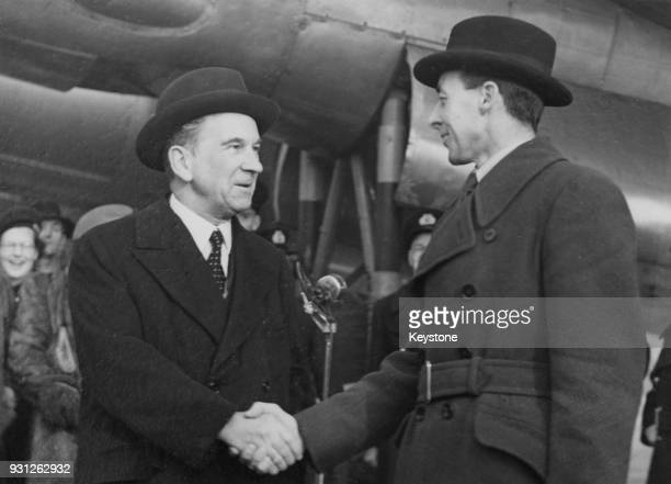 Air Vice Marshal Donald Clifford Tyndall Bennett of the RAF leader of the 'Pathfinder Force' during World War II shakes hands with Lord Winster...