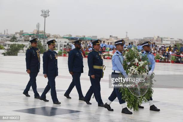 Air Vice Marshal Imran Khalid Air Officer Commanding Pakistan Air Force walks with officers to lay a wreath at the mausoleum of Muhammad Ali Jinnah...