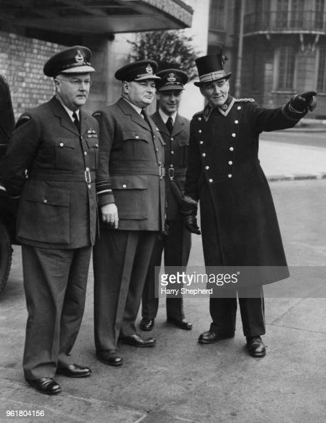 Air Vice Marshal K G Nairn and Air Marshal Lloyd Samuel Breadner Chief of the Canadian Air Staff receive advice from the commissionaire outside the...