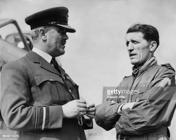Air Vice Marshal Percy Bernard, the 5th Earl of Bandon chats to Wing Commander Denis Smallwood of the RAF at Biggin Hill, UK, during rehearsals for...