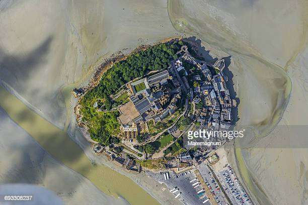 air view of the fortified town during the low tide - モンサンミッシェル ストックフォトと画像