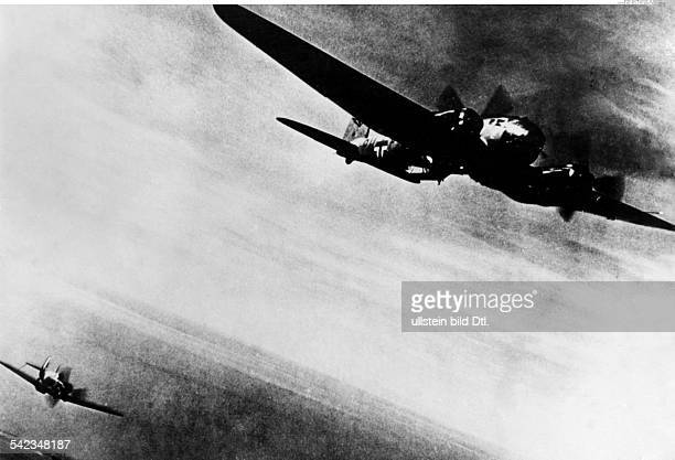 2WW Air War Battle of Britain Air combat a british Spitfire fighter plane attacking a german He 111 bomber above EnglandBy end of 1940