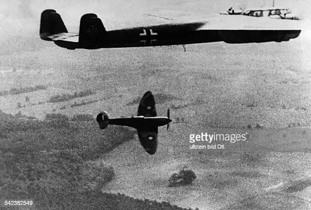 2WW Air War Battle of Britain Air combat between german Do17 bomber and british spitfire above england Autumn 1940