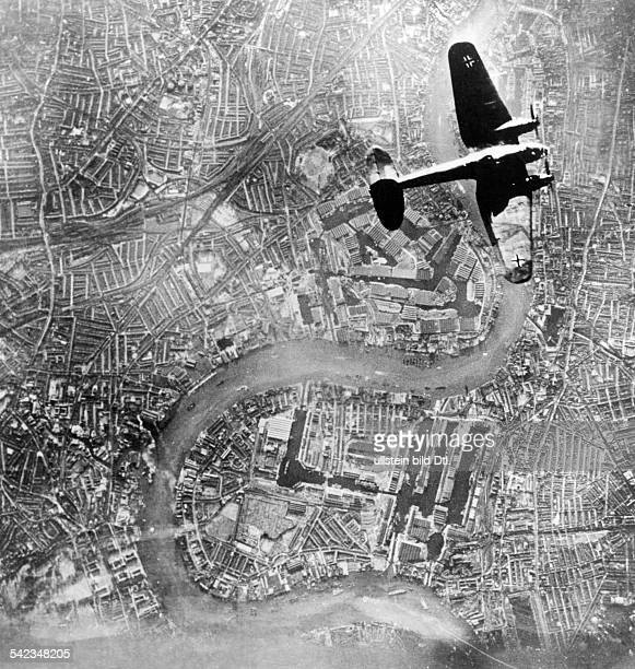 2WW Air War Battle of Britain German bomber He111 above IndiaDocks London