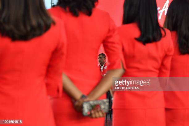AirAsia boss Tony Fernandes speaks during a press conference in Sepang on the outskirts of Kuala Lumpur on July 19 2018 Malaysian budget airline...