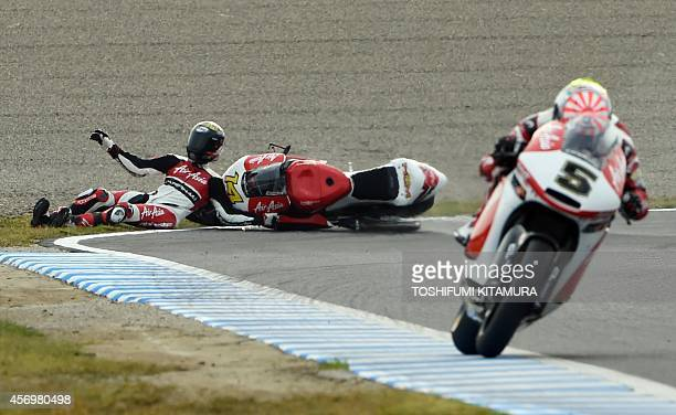 AirAsia Caterham rider Ratthapark Wilairot of Thailand slides off the track while AirAsia Caterham rider Johann Zarco of France passing during the...