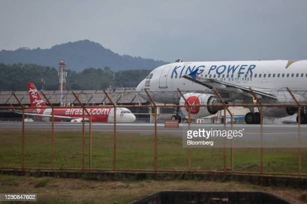 AirAsia Group Bhd. Aircraft at Phuket International Airport in Phuket, Thailand, on Sunday, Dec. 20, 2020. The tepid response to Thailands highly...