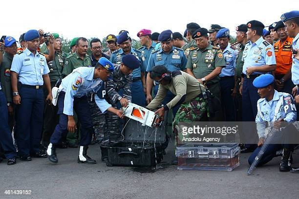 AirAsia QZ8501s Flight Data Recorder is removed from its black box at the at Iskandar Airfield Pangkalanbun Indonesia after being retrieved from a...
