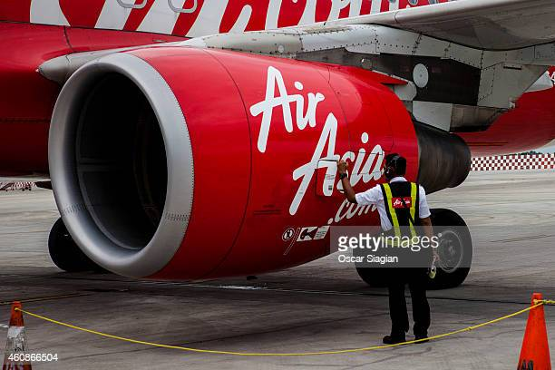 AirAsia Technician checks the airplane for preparation before take off at Soekarno Hatta International Airport on December 28 2014 in Jakarta...