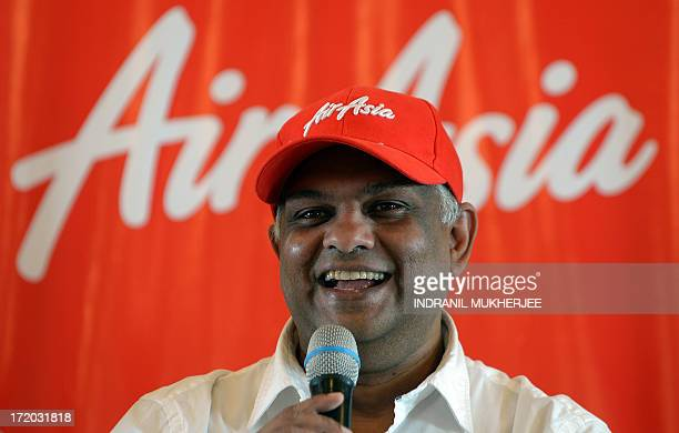 AirAsia's chief executive Tony Fernandes speaks at a press conference in Mumbai on July 1 2013 Malaysiabased Asia's largest budget carrier AirAsia...