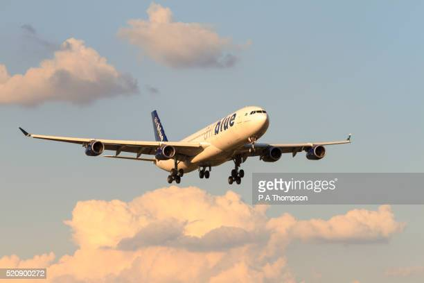 airblue airbus a340 plane coming in to land - airbus stock pictures, royalty-free photos & images