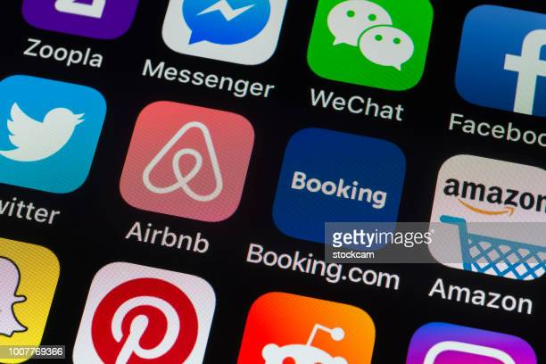 Airbnb, Booking.com and other phone Apps on iPhone screen