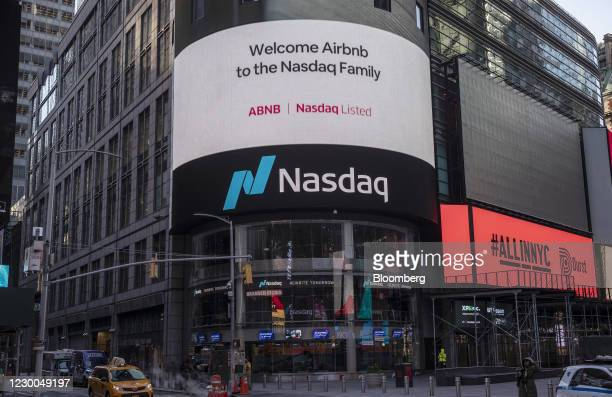 Airbnb Inc. Signage on an electronic monitor during the company's initial public offering at the Nasdaq MarketSite in New York, U.S., on Thursday,...