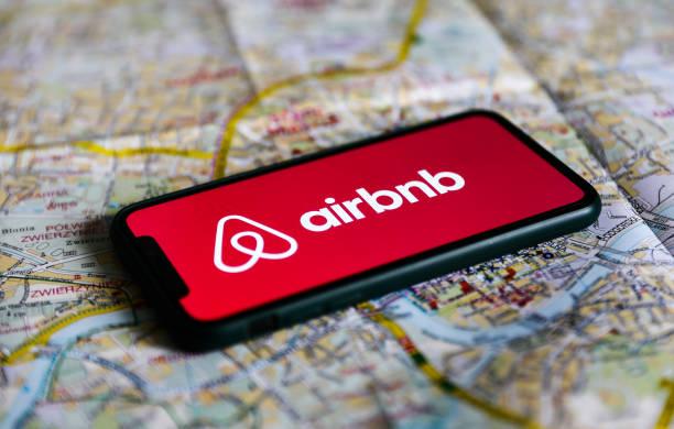 airbnb logo displayed on a phone screen and a map of krakow are seen picture id1234731223?k=20&m=1234731223&s=612x612&w=0&h=gSDW0 NBQQqT2qwx qAzfcQlFTQqICO5RTq2KqGLHj4=