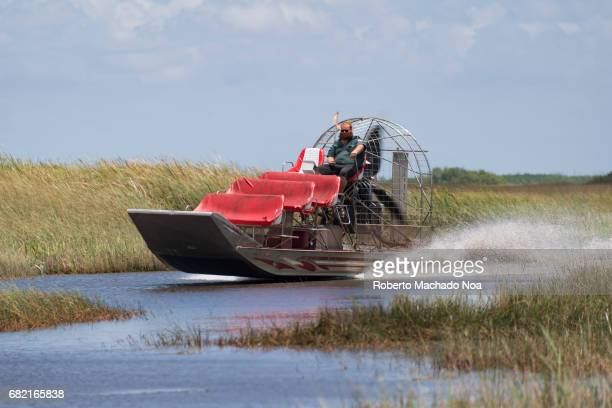 Airboat moving fast in the shallow waters of the Everglades An airboat is a flatbottomed vessel propelled in a forward direction by an aircrafttype...