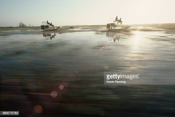 airboaters in everglades - straw boater hat stock pictures, royalty-free photos & images
