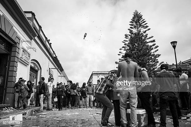 airborne beer bottle during looting in mexico - looting stock pictures, royalty-free photos & images