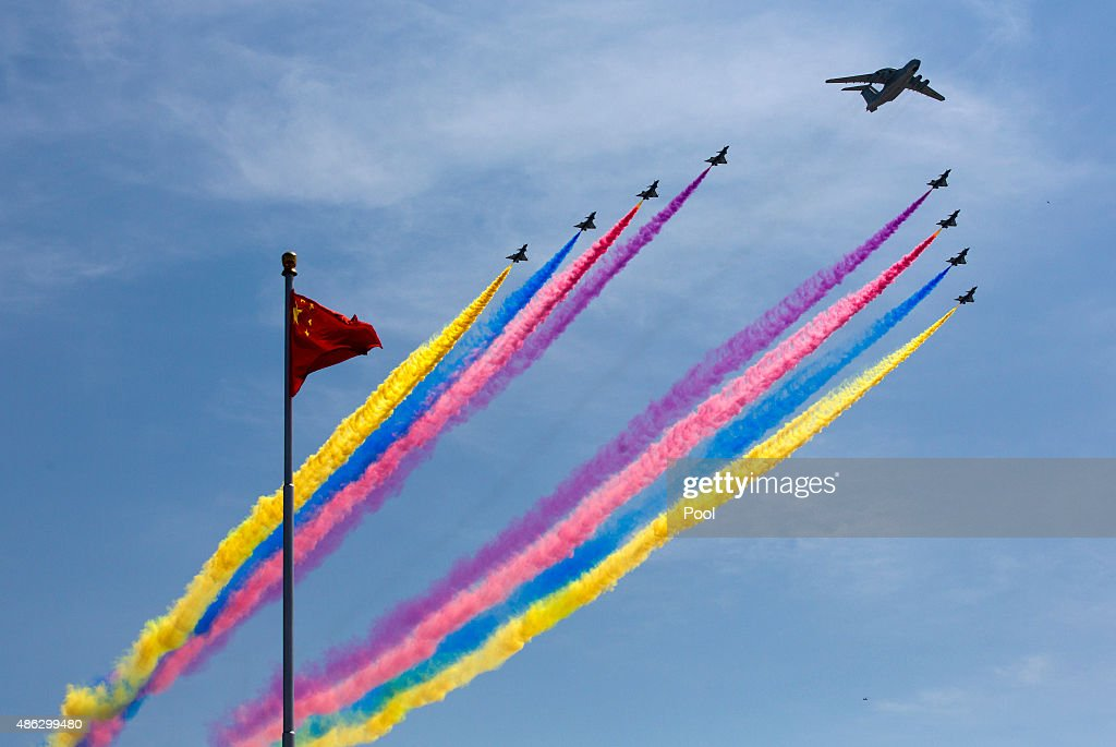 A KJ-2000 airborne early warning and control system leads J-10 fighter jets flying past a national flag during a military parade to mark the 70th anniversary of the end of World War Two on September 3, 2015 in Beijing, China. China is marking the 70th anniversary of the end of World War II and its role in defeating Japan with a new national holiday and a military parade in Beijing.