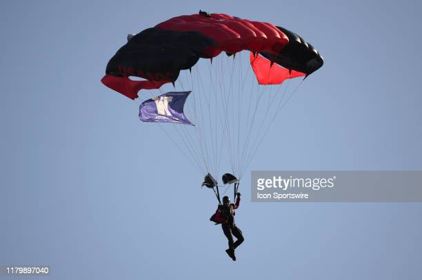 Airborne Rangers bring the game ball in by parachute before a PAC12 Conference game between the Washington Huskies and the Utah Utes on November 2 at...