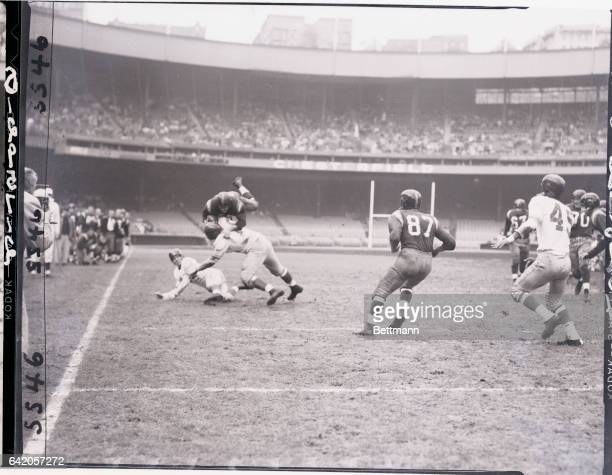 Airborne Redskin New York The Washington Redskins [professional football team met the New York Giants today in the rainsoaked polo grounds In first...