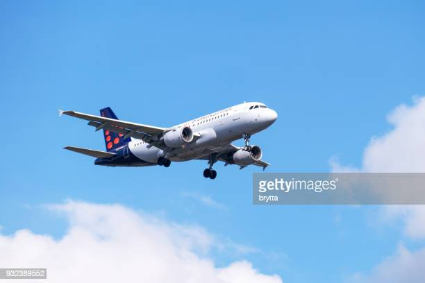 airbus a 319 from brussels airlines approaching brussels airport - brussels airlines stock photos and pictures