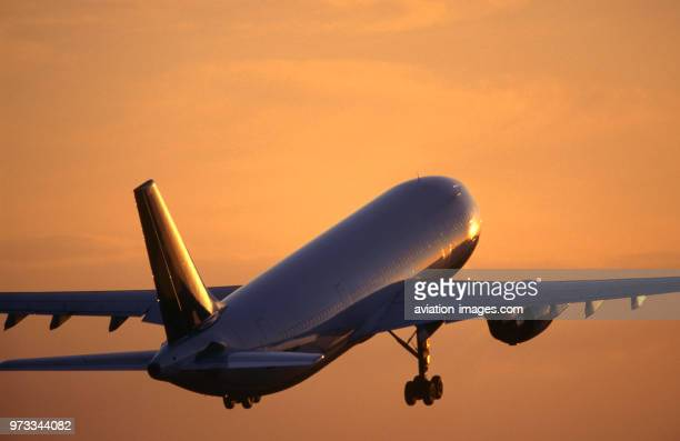 Airbus A300600 climbing after takeoff at dusk