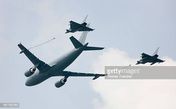 Airbus A310304 MRTT Multi Role Transport Tanker tanker aircraft with two Eurofighter Typhoon 417 fighter aircrafts