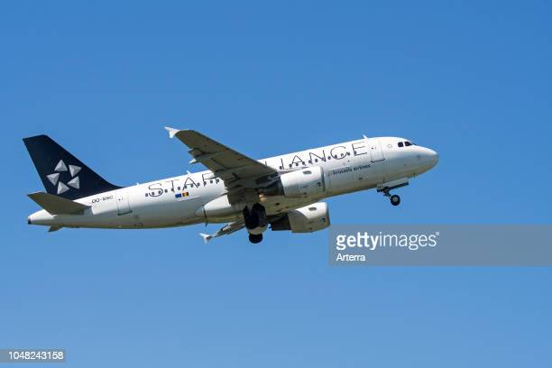 Airbus A319112 narrowbody commercial passenger twinengine jet airliner from Belgian Brussels Airlines in flight against blue sky