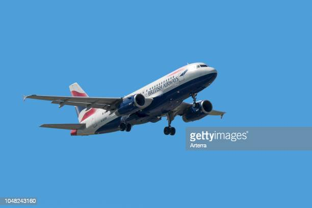 Airbus A319131 narrowbody commercial passenger twinengine jet airliner from British Airways in flight against blue sky