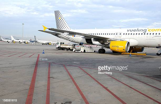 Airbus A320 aircraft operated by Vueling Airlines SA stand at EL Prat airport in Barcelona Spain on Wednesday Dec 19 2012 International Consolidated...