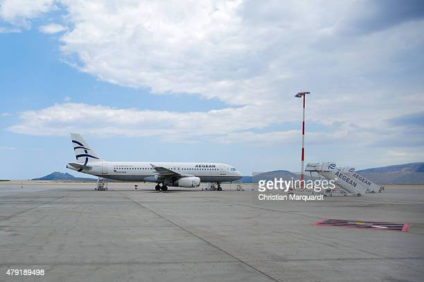 A airbus A320 from the flight company Aegean parks at the Santorini Airport field on June 10 2015 in Santorini Greece Santorini is an island in the...