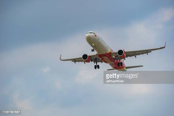 Airbus A321 airplane of Vietjet landing at Tan Son Nhat Airport (SGN) in Saigon sunset