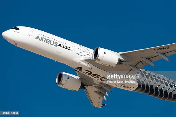 Airbus A350 XWB aircraft manufactured by Airbus SAS performs an aerial display during the Dubai Airshow 2015 on November 9 2015 in Dubai United Arab...