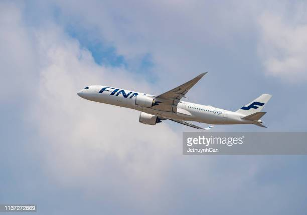 Airbus A350-900 airplane of Finnair taking off at Tan Son Nhat Airport (SGN) in Saigon