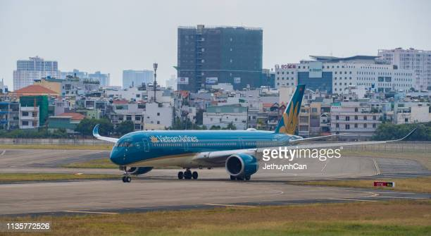 Airbus A350-900 airplane of Vietnam Airlines taxiing on runway of Tan Son Nhat Airport (SGN) in Saigon