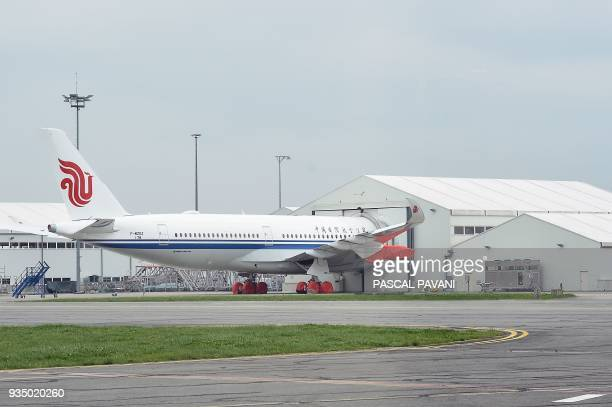 Airbus A350900 of Air China is pictured on the tarmac at the assembly unit on March 20 2018 in Blagnac near Toulouse southwestern France / AFP PHOTO...