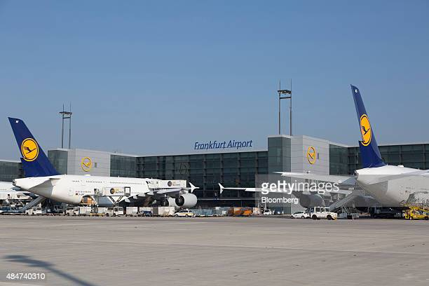 Airbus A380 aircraft operated by Deutsche Lufthansa AG sit on the tarmac outside terminal Aplus at Frankfurt Airport operated by Fraport AG in...