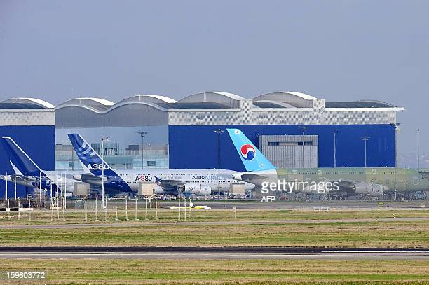 Airbus A380 are seen at Airbus A380 plant in Blagnac near Toulouse on January 17 2013 AFP PHOTO/REMY GABALDA