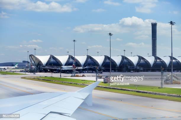 Airbus A380 of Emirates passing departure terminal