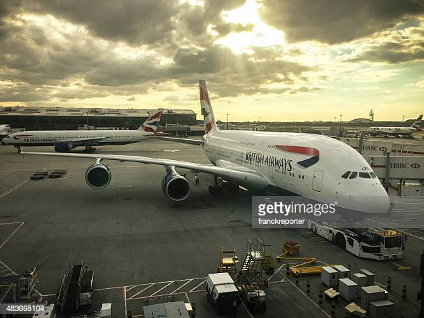 airbus a380 parked on the runway airport - british airways pilot stock photos and pictures