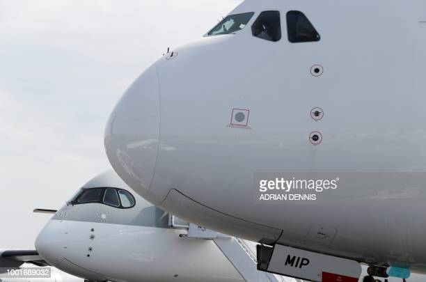 Airbus aircraft are pictured on the tarmac at the Farnborough Airshow south west of London on July 19 2018