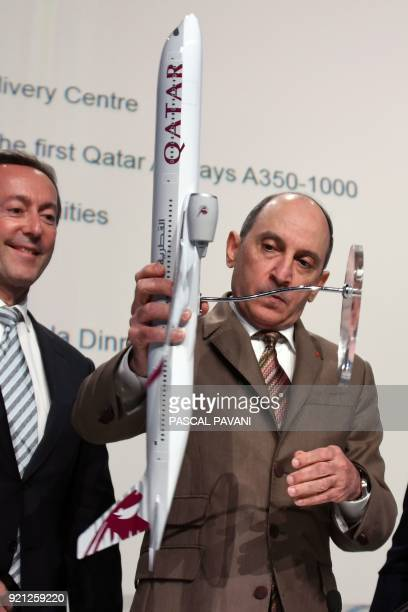 Airbus Aircraft Chief Excutive Officer Fabrice Bregier and Group Chief Executive of Qatar Airways Akbar Al Baker pose with a model aircraft during a...