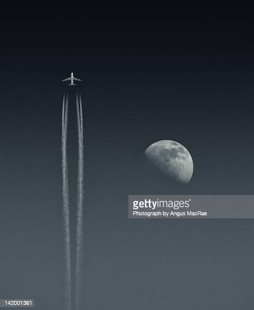 Airbus aircraft passing moon