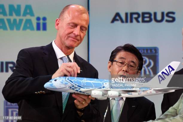 Airbus Chief Executive Officer Tom Enders and the President and CEO of ANA Holdings Inc Shinya Katanozaka attend a ceremony for the delivery of the...