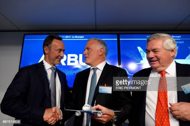 Airbus COO and President Commercial Aircraft Fabrice Bregier and President and CEO of GE Capital Aviation Services Alec Burger shakes hands next to...