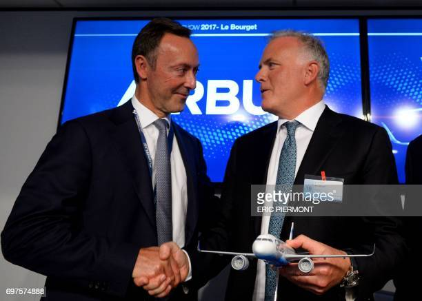 Airbus COO and President Commercial Aircraft Fabrice Bregier and President and CEO of GE Capital Aviation Services Alec Burger shakes hands during a...