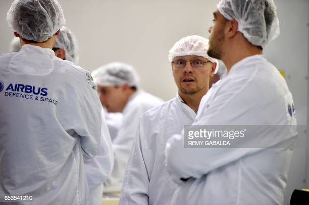 Airbus Defence and Space researchers work during the presentation of the satellite Eutelsat 172B the first entirely electric European satellite at...