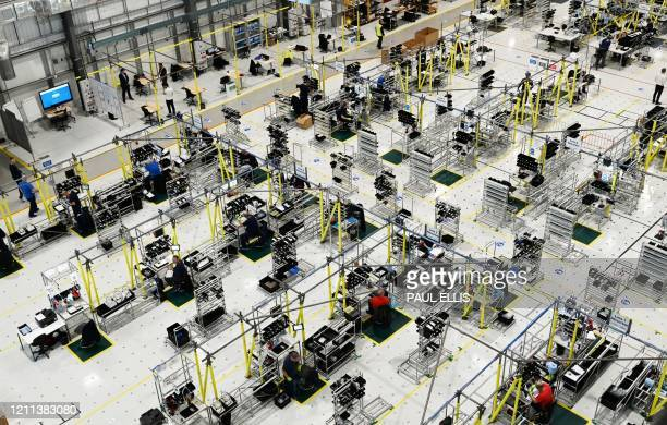 TOPSHOT Airbus employees work on the assembly line to produce ventilators at the Advanced Manufacturing Research Centre in Broughton north Wales on...