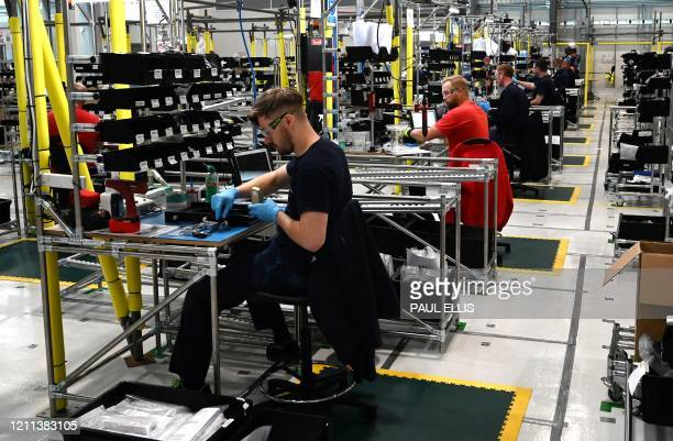 Airbus employees work on the assembly line to produce ventilators at the Advanced Manufacturing Research Centre in Broughton north Wales on April 30...